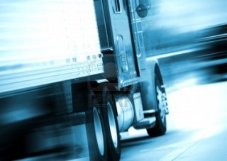 10645091-semi-truck-in-motion-semi-track-speeding-on-the-american-highway-motion-blurred-blue-tones-transport